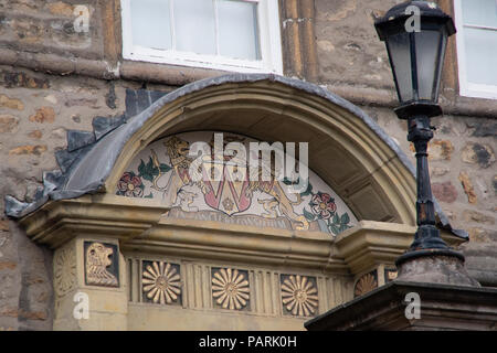 Coat of arms above the door of the building next to the Priory and Judges Lodgings Lancaster city centre around the castle area - Stock Photo