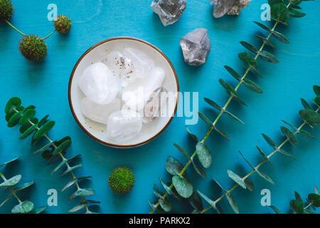 Clear Quartz and Eucalyptus on Turquoise Table - Stock Photo