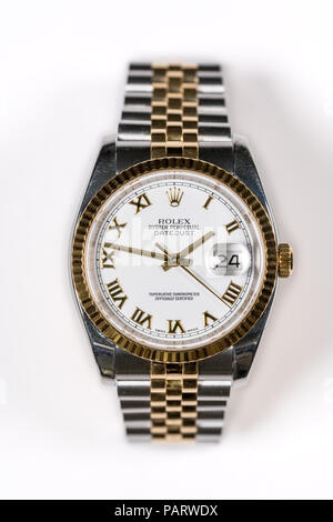 Rolex Oyster Datejust mens watch against white background - Stock Photo
