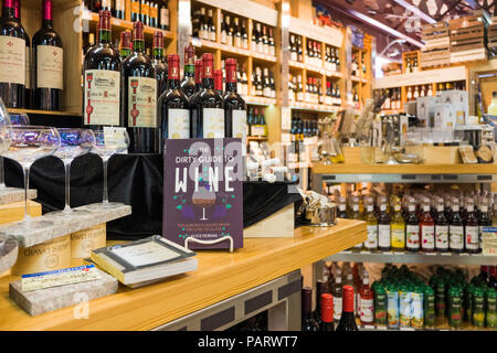 Wine bottles on the shelves of a wine store in California, USA - Stock Photo