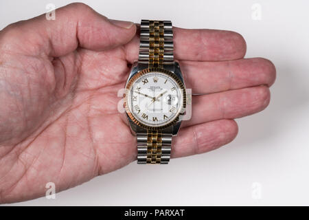 Rolex Oyster Datejust mens watch in old male hand - Stock Photo