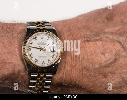 Rolex Oyster Datejust mens watch on old male wrist - Stock Photo