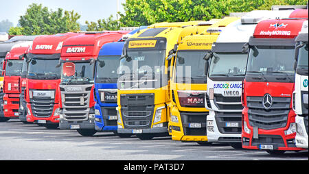 Foreign numberplate on hgv lorry truck & trailers at overnight parking on M25 motorway Thurrock services for diesel trucks & lorries Essex England UK - Stock Photo
