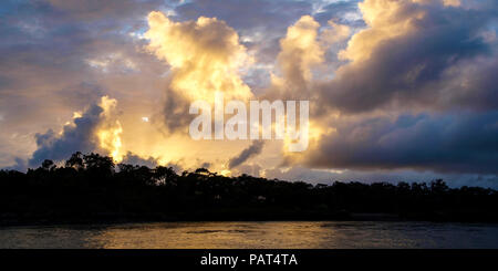 A Vibrant atmospheric cloudy sky cloudscape with white coloured Cumulonimbus cloud formation in a grey sky. Beauty in nature. New South Wales, Austral - Stock Photo