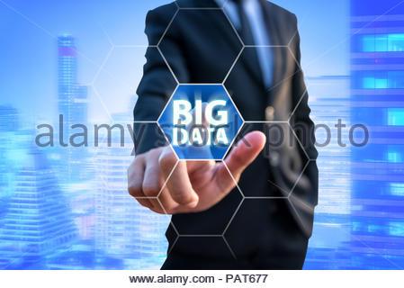 Smart Businessman Touching Big Data Technology for Business Plan - Stock Photo