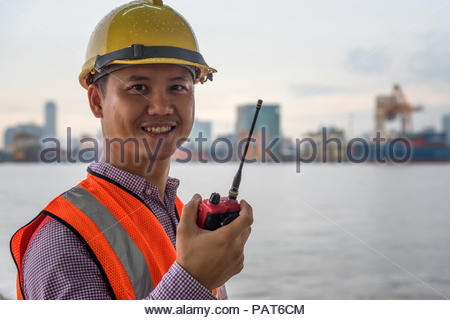 Engineer Radio Communication and As-Built Drawing at river side port transportation - Stock Photo