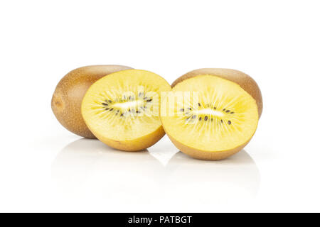 Group of two whole two halves of fresh golden brown kiwi fruit sungold variety one sliced isolated on white - Stock Photo