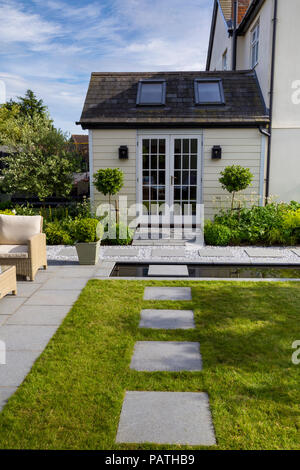 View of London Stone granite paving slabs looking towards the house exterior - Stock Photo