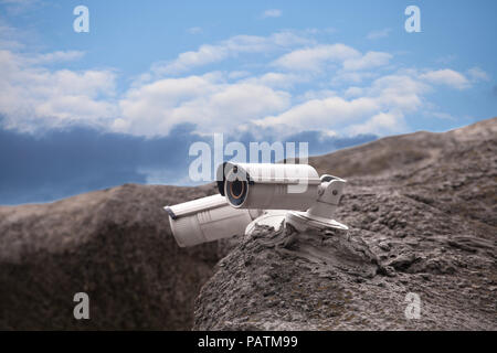 Rock Camera Surveillance : Surveillance security camera on the rock isolated on white