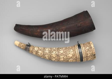 Horn (Oliphant) with Case. Culture: South Italian. Dimensions: Horn (a); 23 1/16 x 4 15/16 x 4 in. (58.6 x 12.5 x 10.2 cm); case (b); 22 5/8 x 5 7/8 x 5 7/16 in. (57.5 x 15 x 13.8 cm). Date: horn, 11th-12th century; case, 16th century. Museum: Metropolitan Museum of Art, New York, USA. - Stock Photo