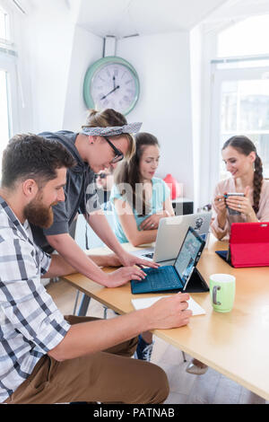 man and woman cooperating as co-workers in collaborative office  - Stock Photo