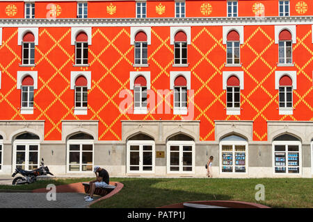 The freshly repainted Ministry of Agriculture on the edge of Skanderbeg Square in the centre of Tirana, Albania, - Stock Photo