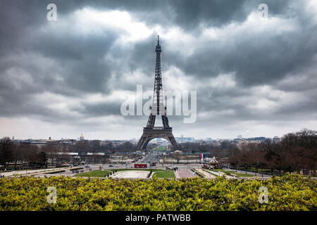 The famous Tour Eiffel at the end of winter under storm clouds - Stock Photo