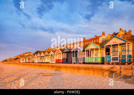 Beach huts in early morning light at Southwold, Suffolk. - Stock Photo