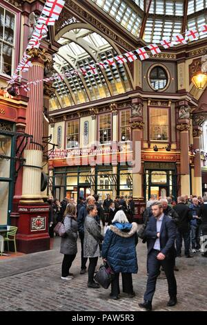 LONDON, UK - APRIL 22, 2016: People celebrate Saint George's Day in Leadenhall Market, London. Saint George is the patron saint of England. - Stock Photo