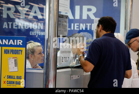 Mallorca, Spain.  25 July 2018, Mallorca, Spain: Passengers are queuing up at the Ryanair service desk at Palma de Mallorca airport. The start of a two-day strike by cabin crew at the low-cost airline Ryanair has caused great displeasure among countless travellers in several European countries. The most cancellations occurred in Spain, n. Photo: Clara Margais/dpa Credit: dpa picture alliance/Alamy Live News - Stock Photo