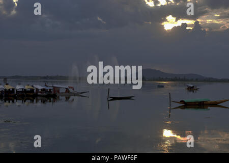 July 25, 2018 - Budgam, Jammu And Kashmir, India - Boats are seen moored at the lake..On a rainy day around Dal Lake in Srinagar, the summer capital of Indian administered Kashmir, India. (Credit Image: © Masrat Zahra/SOPA Images via ZUMA Wire) - Stock Photo