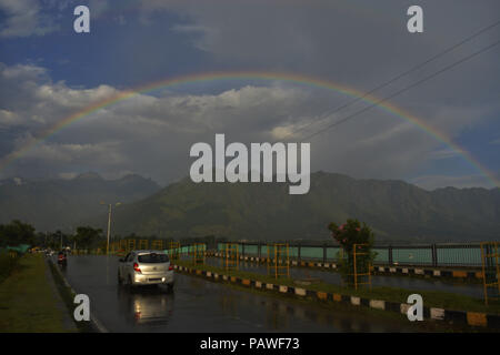 July 25, 2018 - Budgam, Jammu And Kashmir, India - A rainbow is seen over the Zabrwan hills..On a rainy day around Dal Lake in Srinagar, the summer capital of Indian administered Kashmir, India. (Credit Image: © Masrat Zahra/SOPA Images via ZUMA Wire) - Stock Photo