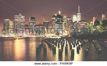 Vintage toned picture of manhattan at night. - Stock Photo
