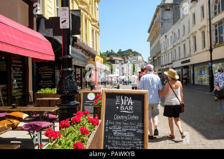 Cafes in Robertson Street, Hastings, looking towards the Castle, East Sussex, UK - Stock Photo