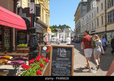 Hastings, cafes in Robertson Street, looking towards the Castle, East Sussex, UK - Stock Photo