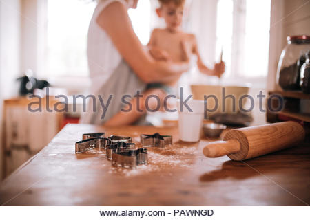 Family making cookies at home - Stock Photo