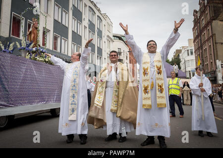 Annual procession of Madonna del Carmine (Our Lady of Mount Carmel) by British Italians outside St. Peter's Italian church in Clerkenwell, London, UK. - Stock Photo
