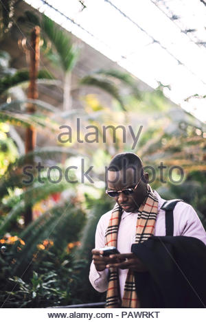 Young business man on smart phone - Stock Photo