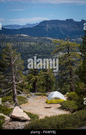 Campers set up a nylon tent at an overlook along the forest at Ebbetts Pass, California - Stock Photo