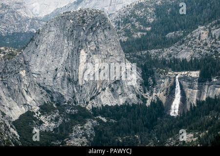 Granite Valley and Dome Landscape, With Flowing Nevada Falls - Taken from Wawona (Glacier Point Road) - Yosemite National Park - Stock Photo