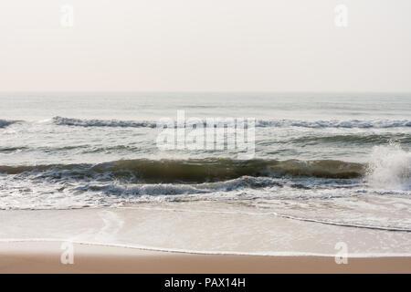 Calm waves on beach - Calm sea waves at morning time on a tropical beach. - Stock Photo