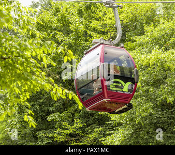 Thale, Saxony-Anhalt, Germany, July 23. 2018: Red cabin of the cable car of Thale in the Harz mountains between the green summer trees - Stock Photo