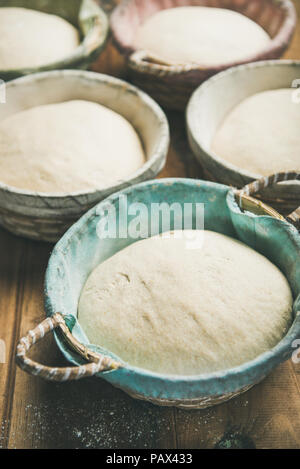 Sourdough for baking homemade bread in baskets, selective focus