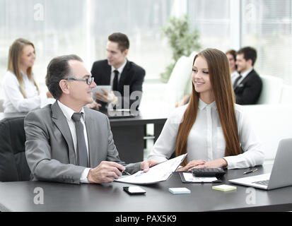 Marketer and team Manager working with paper charts. - Stock Photo