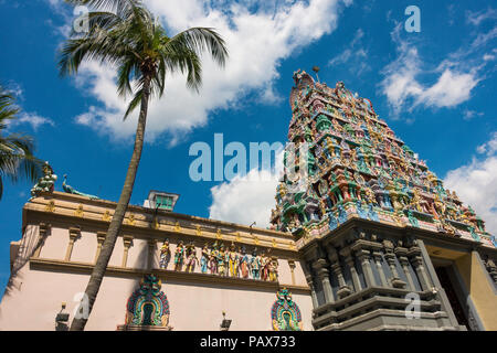 Detailed, colorful religious Hindu temple walls & exterior of Sri Thendayuthapani in Singapore City - Stock Photo