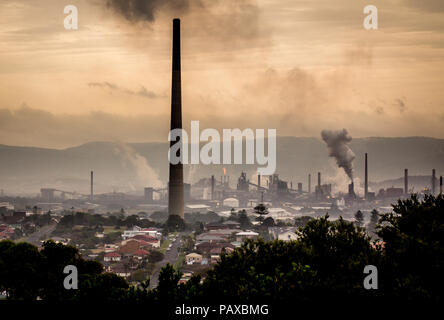 Climate change concept industrial landscape with chimney stacks showing emissions of steam and smoke from industrial works, Port Kembla, NSW Australia - Stock Photo