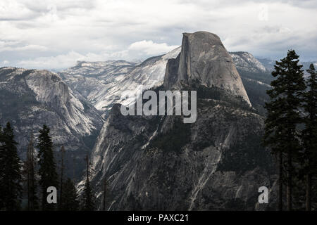 Valley view of Half Dome and alpine forest, covering Cloud's Rest - Taken from Wawona (Glacier Point Road) - Yosemite National Park - Stock Photo