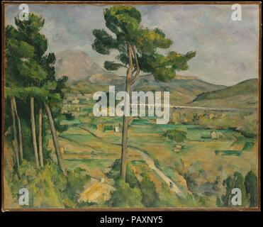 Mont Sainte-Victoire and the Viaduct of the Arc River Valley. Artist: Paul Cézanne (French, Aix-en-Provence 1839-1906 Aix-en-Provence). Dimensions: 25 3/4 x 32 1/8 in. (65.4 x 81.6 cm). Date: 1882-85.    The distinctive silhouette of Mont Saint-Victoire rises above the Arc River valley near the town of Aix. To paint this scene, Cézanne stood close to Montbriand, his sister's property, at the top of the hill just behind her house; the wall of the neighboring farmhouse is barely visible. Cézanne sought to reveal the inner geometry of nature, 'to make of Impressionism something solid and durable, - Stock Photo