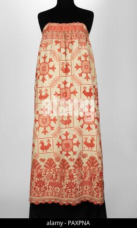 Apron. Culture: Russian. Date: 1830-70.  This object is from the collection of Natalia de Shabelsky (1841-1905), a Russian noblewoman compelled to preserve what she perceived as the vanishing folk art traditions of her native country. Traveling extensively throughout Great Russia, she collected many fine examples of textile art of the wealthy peasant class. From the 1870s until moving to France in 1902, Shabelsky amassed a large collection of intricately embroidered hand-woven household textiles and opulent festival garments with rich decoration and elaborate motifs. The Brooklyn Museum holdin - Stock Photo