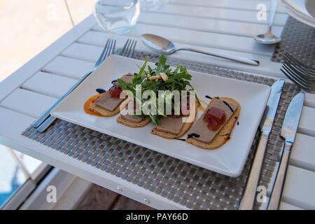 Pate and toast is served at Restaurant Perla Blanca in Peniscola Northern Spain - Stock Photo