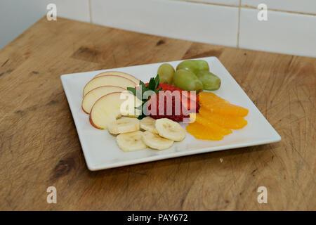 A platter of fresh fruit at Restaurant Perla Blanca in Peniscola Northern Spain - Stock Photo