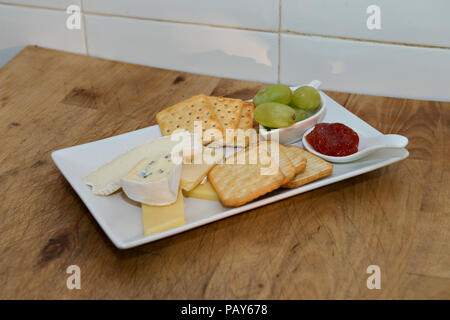 A plate of cheese and biscuits at Restaurant Perla Blanca in Peniscola Northern Spain - Stock Photo