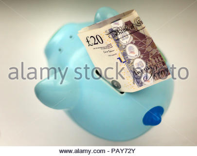 Embargoed to 0001 Thursday July 26 File photo dated 06/01/15 of money in a piggy bank. Hard-pressed households need stronger action to help them deal with debts and save for a rainy day and a pension, MPs have urged. - Stock Photo