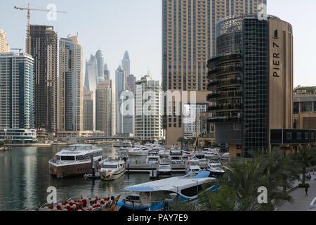 DUBAI, UAE - February 14, 2018: View of modern skyscrapers in morning light in Dubai Marina, UAE - Stock Photo