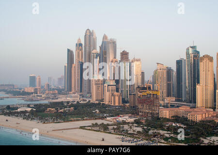 DUBAI, UAE - February 16, 2018: Aerial view of modern skyscrapers and beach at Jumeirah Beach Residence (JBR) during sunset in Dubai, UAE - Stock Photo