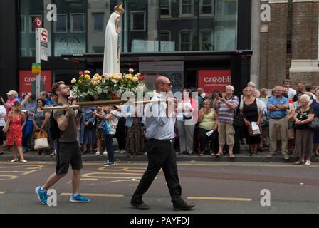 Christianity UK. Roman Catholic procession people Italian community annual procession Saint Peters,  St Peters Italian Church London people watching   HOMER SYKES - Stock Photo