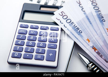 business still-life from a calculator and a bundle of banknotes 500 euros close up - Stock Photo
