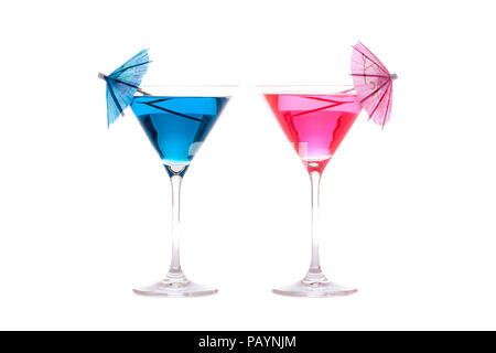 His and hers party or vacation cocktails. Neon blue and pink summer fun alcoholic drinks in cocktail glasses with decorative umbrellas. Isolated again - Stock Photo