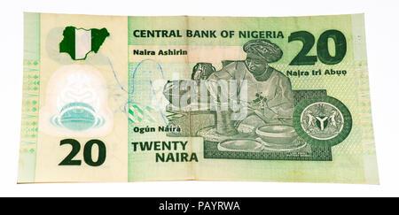 20 Nigerian naira bank note. Nigerian naira is the main currency of Nigeria - Stock Photo