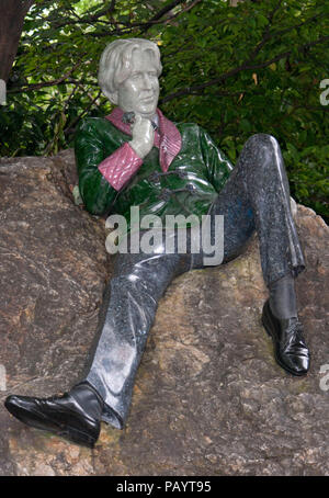 Statue on a rock of Oscar Wilde in Merrion Square Dublin Ireland - Stock Photo